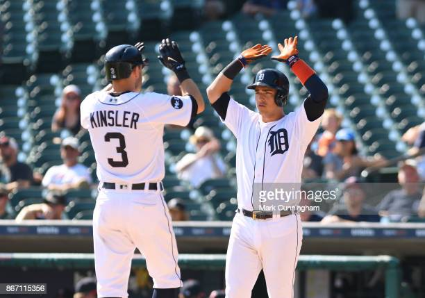 Ian Kinsler and Jose Iglesias of the Detroit Tigers highfive during the game against the Minnesota Twins at Comerica Park on September 24 2017 in...