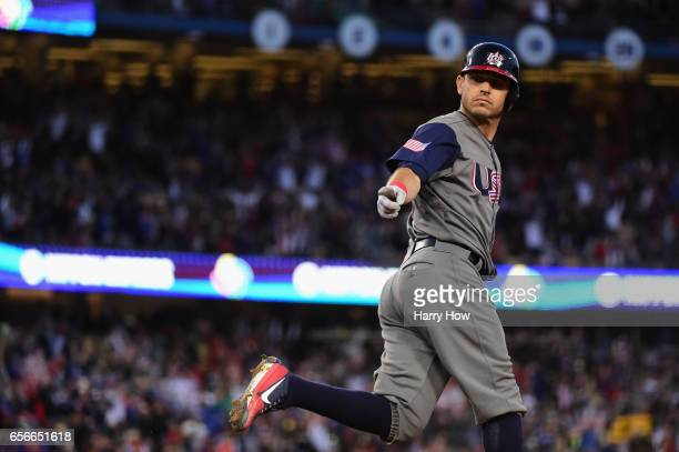 Ian Kinsler of team United States reacts as he rounds the bases after hitting a tworun home run to take a 20 lead in the third inning over Puerto...