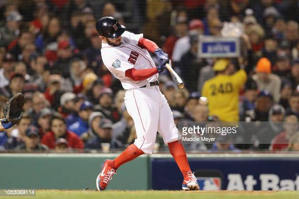 Ian Kinsler of the Boston Red Sox hits an RBI single during the second inning against the Los Angeles Dodgers in Game Two of the 2018 World Series at...