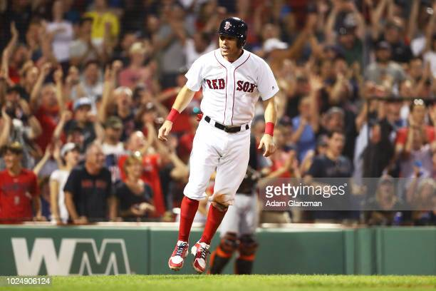 Ian Kinsler of the Boston Red Sox reacts after scoring on a wild pitch by Tayron Guerrero of the Miami Marlins to take the lead in the eighth inning...