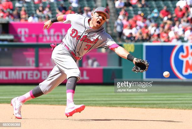 Ian Kinsler of the Detroit Tigers can't reach a single by Andrelton Simmons of the Los Angeles Angels in the seventh inning of the game at Angel...