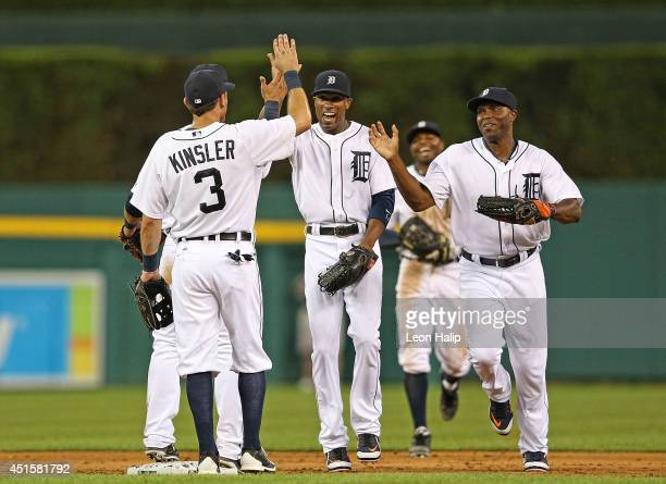 Ian Kinsler of the Detroit Tigers celebrates a win over the Oakland Athletics with teammates Austin Jackson and Torii Hunter at Comerica Park on July...