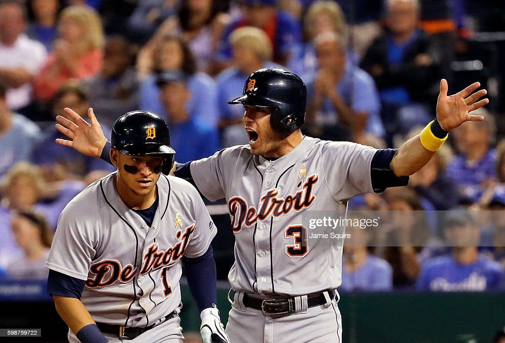 Ian Kinsler #3 of the Detroit Tigers celebrates with Jose Iglesias #1 after Iglesias scored the game-winning run during the 9th inning as the Tigers defeated the Kansas City Royals 7-6 to win the game at Kauffman Stadium on September 2, 2016 in Kansas City, Missouri.