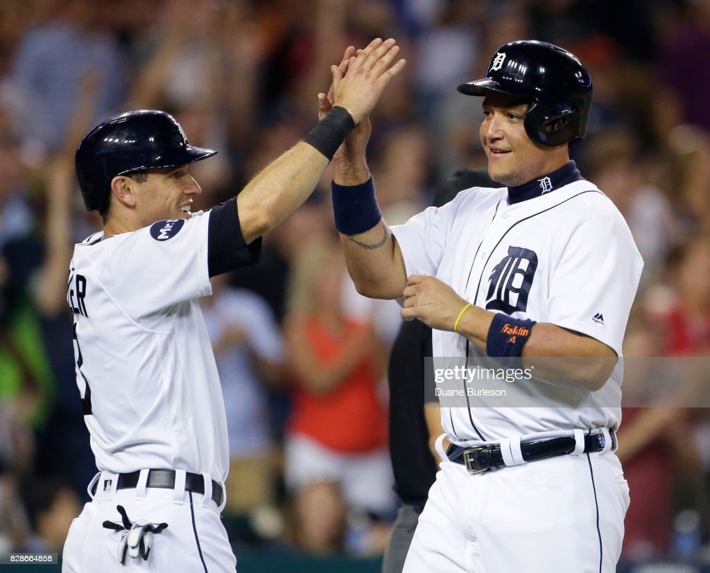 Ian Kinsler #3 of the Detroit Tigers celebrates with Miguel Cabrera #24 of the Detroit Tigers after scoring against the Pittsburgh Pirates on a three-run triple hit by Nicholas Castellanos of the Detroit Tigers during the seventh inning of an interleague game at Comerica Park on August 9, 2017 in Detroit, Michigan.