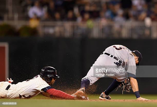 Ian Kinsler of the Detroit Tigers doubles Aaron Hicks of the Minnesota Twins off second base during the sixth inning of the game on September 16 2015...