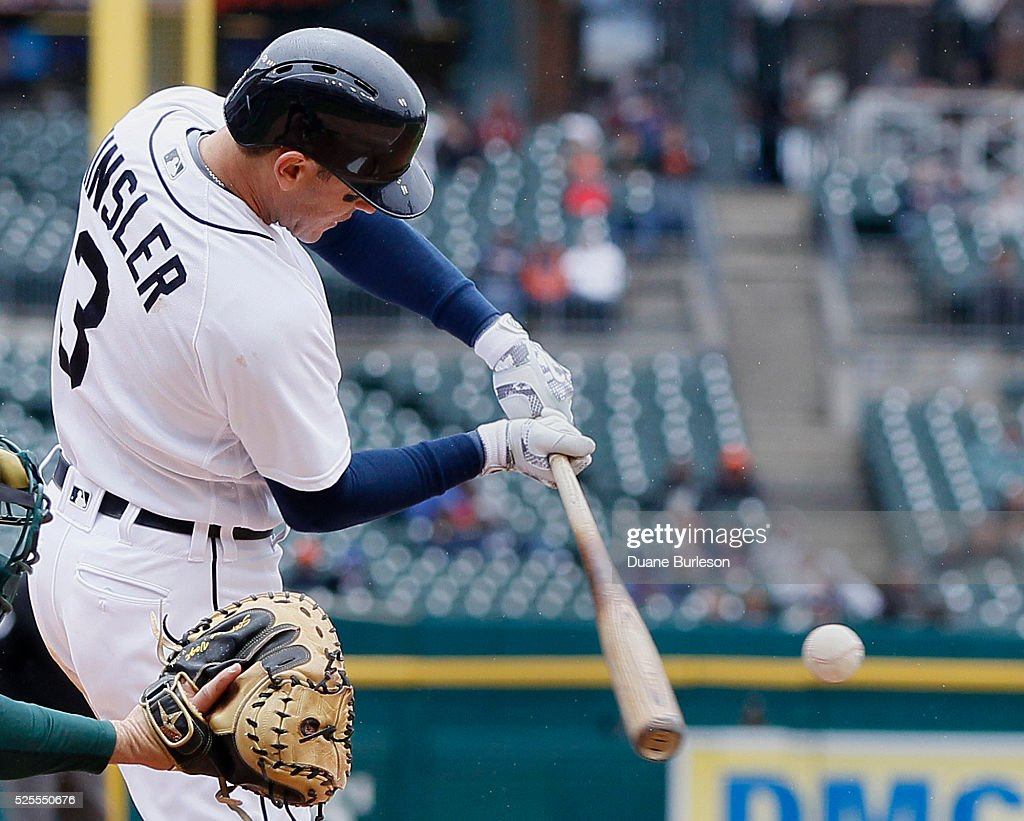 Ian Kinsler #3 of the Detroit Tigers doubles against the Oakland Athletics to drive in Anthony Gose during the third inning at Comerica Park on April 28, 2016 in Detroit, Michigan.