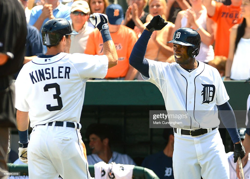 Ian Kinsler #3 of the Detroit Tigers gets a high-five from Austin Jackson #14 after hitting a home run in the second inning of the spring training game against the Houston Astros at Joker Marchant Stadium on March 15, 2014 in Lakeland, Florida. The Tigers defeated the Astros 14-3.
