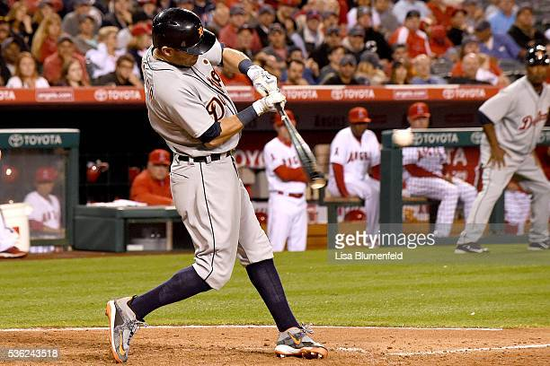 Ian Kinsler of the Detroit Tigers hits a grand slam homerun in the seventh inning against the Los Angeles Angels of Anaheim at Angel Stadium of...