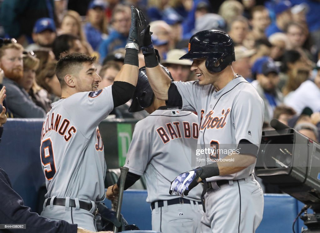 Ian Kinsler #3 of the Detroit Tigers is congratulated by Nick Castellanos #9 after hitting a solo home run in the seventh inning during MLB game action against the Toronto Blue Jays at Rogers Centre on September 8, 2017 in Toronto, Canada.
