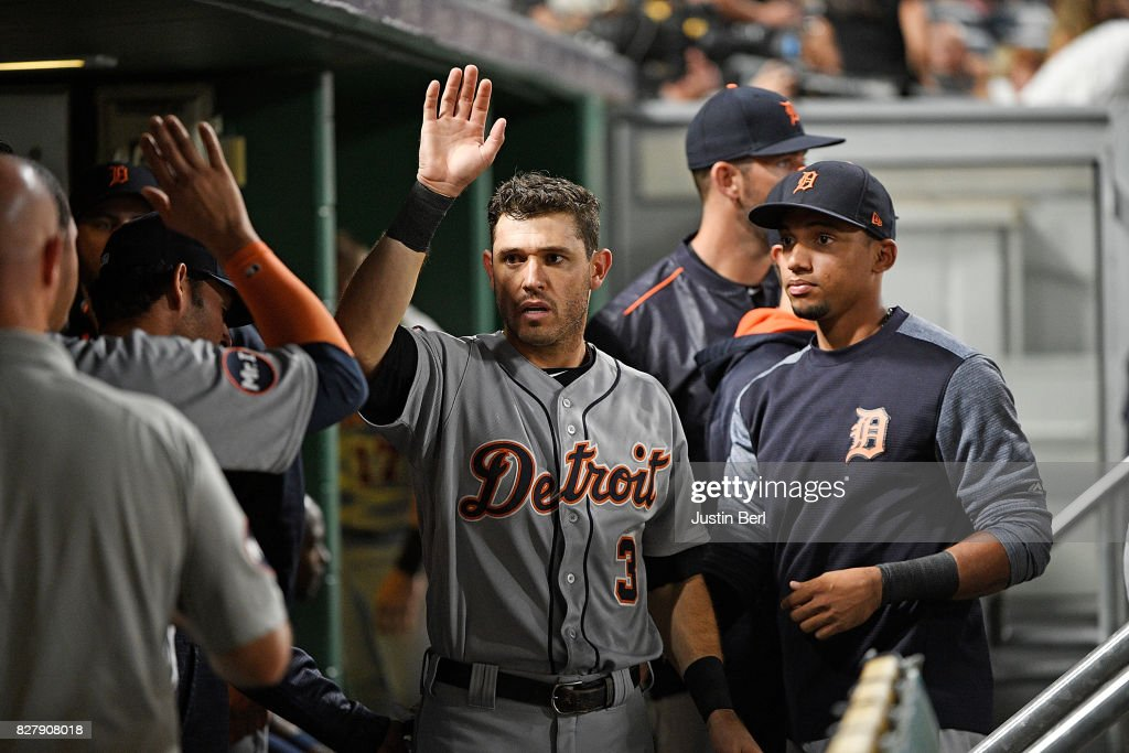 Ian Kinsler #3 of the Detroit Tigers is met by teammates in the dugout after coming around to score on an RBI double by Jim Aducci #37 in the sixth inning during the game against the Pittsburgh Pirates at PNC Park on August 8, 2017 in Pittsburgh, Pennsylvania.