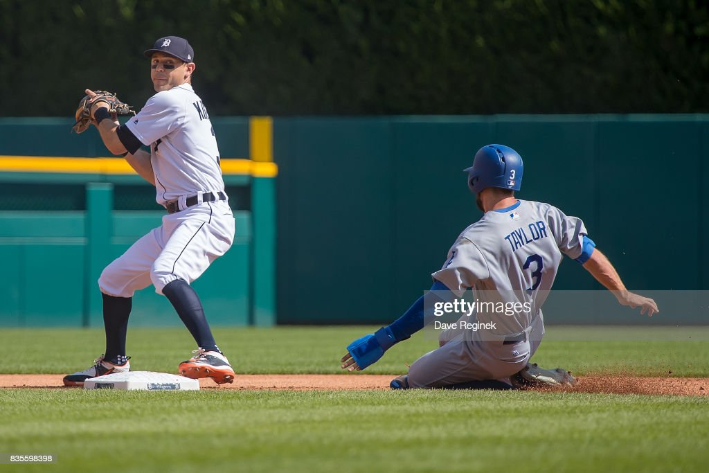 Ian Kinsler #3 of the Detroit Tigers makes a play at second base to get out Chris Taylor #3 of the Los Angeles Dodgers in the first inning during a MLB game at Comerica Park on August 19, 2017 in Detroit, Michigan.