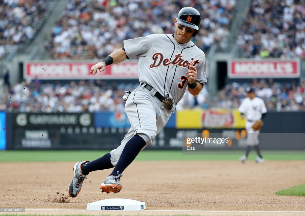 Ian Kinsler #3 of the Detroit Tigers rounds third and scores on a double from teamamte Justin Upton in the first inning against the New York Yankees on August 2, 2017 at Yankee Stadium in the Bronx borough of New York City.