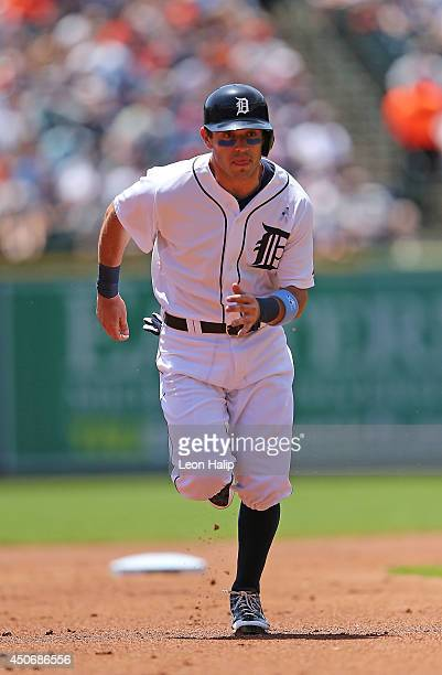 Ian Kinsler of the Detroit Tigers runs to third base during the first inning of the game against the Minnesota Twins at Comerica Park on June 15 2014...