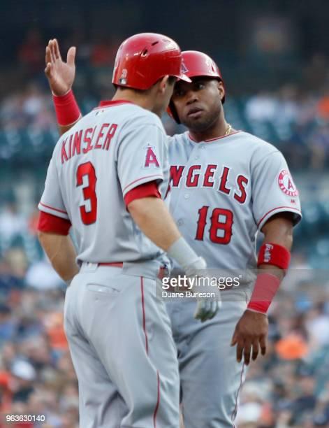Ian Kinsler of the Los Angeles Angels celebrates with Luis Valbuena of the Los Angeles Angels after hitting a threerun home run against the Detroit...
