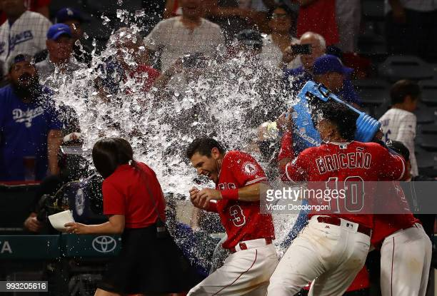 Ian Kinsler of the Los Angeles Angels of Anaheim is doused with a sports drink by teammates Jose Briceno and Andrelton Simmons after their MLB game...