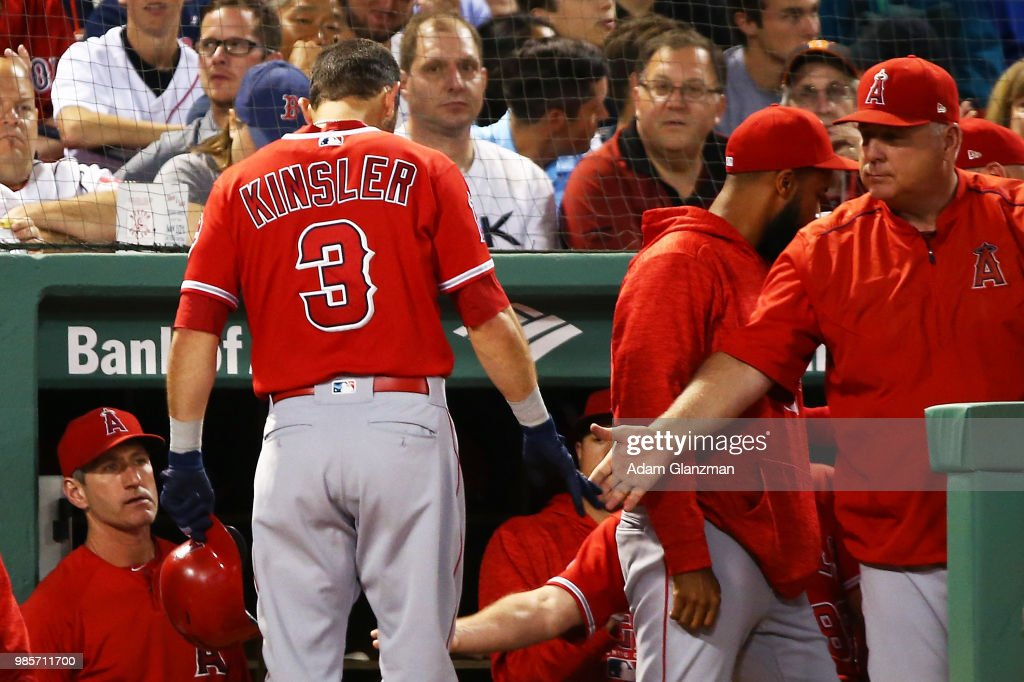 Ian Kinsler #3 of the Los Angeles Angels returns to the dugout after hitting a solo home run in the fifth inning of a game against the Boston Red Sox at Fenway Park on June 27, 2018 in Boston, Massachusetts.