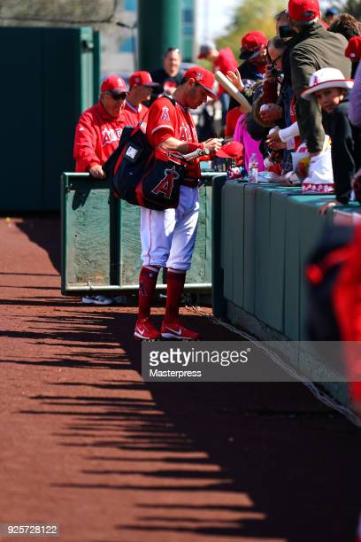 Ian Kinsler of the Los Angeles Angels signs autographs for fans prior to the game between Cleveland Indians and Los Angeles Angels on February 28...