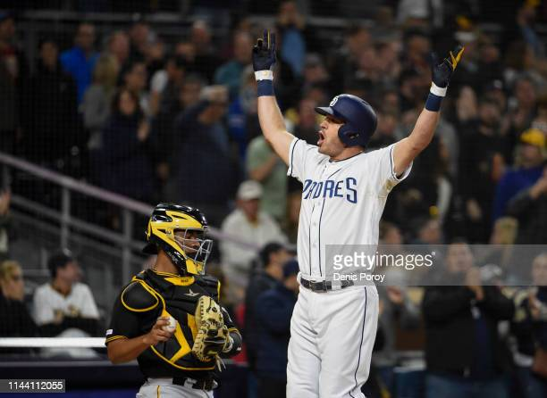 Ian Kinsler of the San Diego Padres celebrates after hitting a threerun home run during the sixth inning of a baseball game against the Pittsburgh...