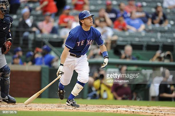 Ian Kinsler of the Texas Rangers bats and runs to first base from the batter's box during the game against the Seattle Mariners at Rangers Ballpark...