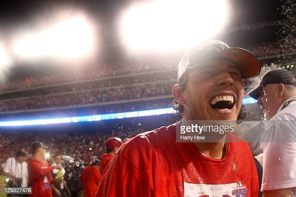 Ian Kinsler of the Texas Rangers celebrates on the field after defeating the Detroit Tigers in Game Six of the American League Championship Series...
