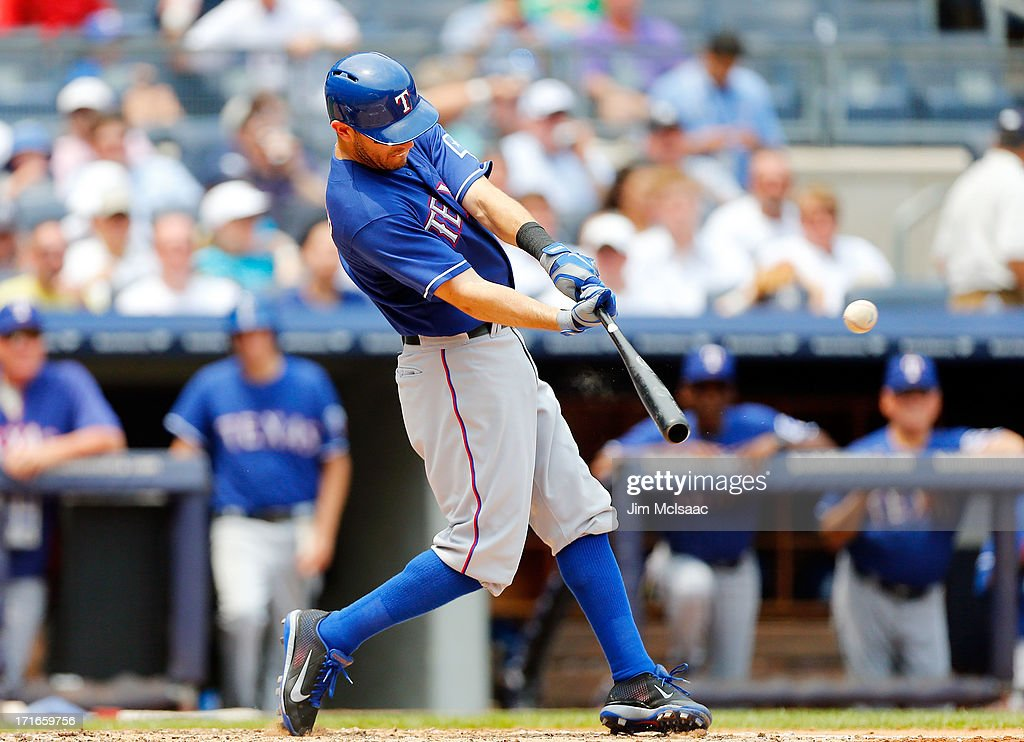 Ian Kinsler #5 of the Texas Rangers connects on a third inning run scoring sacrifice fly against the New York Yankees at Yankee Stadium on June 27, 2013 in the Bronx borough of New York City.