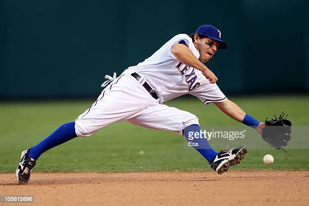 Ian Kinsler of the Texas Rangers fields a ground ball hit by Lance Berkman of the New York Yankees in Game Two of the ALCS during the 2010 MLB...
