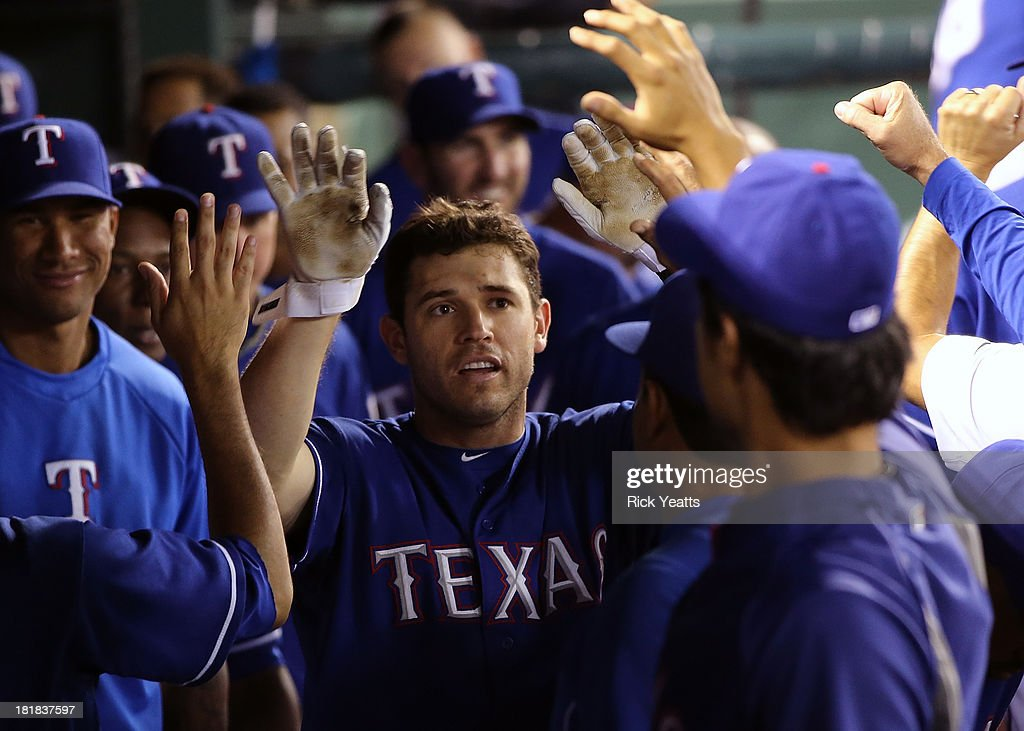 Ian Kinsler #5 of the Texas Rangers is congratulated by his teammates for hitting a solo home run in the sixth inning against the Houston Astros at Rangers Ballpark in Arlington on September 25, 2013 in Arlington, Texas.