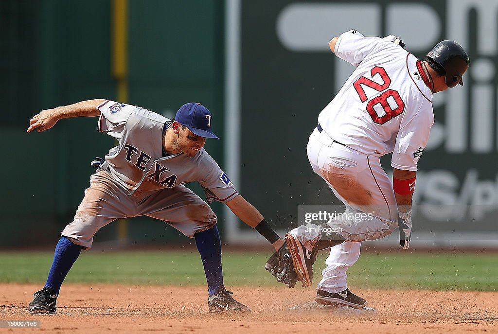 Ian Kinsler #5 of the Texas Rangers places a late tag on Adrian Gonzalez #28 of the Boston Red Sox on his double at Fenway Park August 8, 2012 in Boston, Massachusetts.