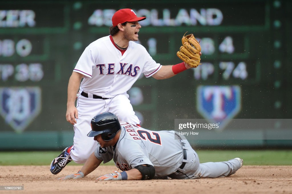 Ian Kinsler #5 of the Texas Rangers reacts as Jhonny Peralta #27 of the Detroit Tigers slides in safe at second base on a double in the third inning of Game Two of the American League Championship Series at Rangers Ballpark in Arlington on October 10, 2011 in Arlington, Texas.