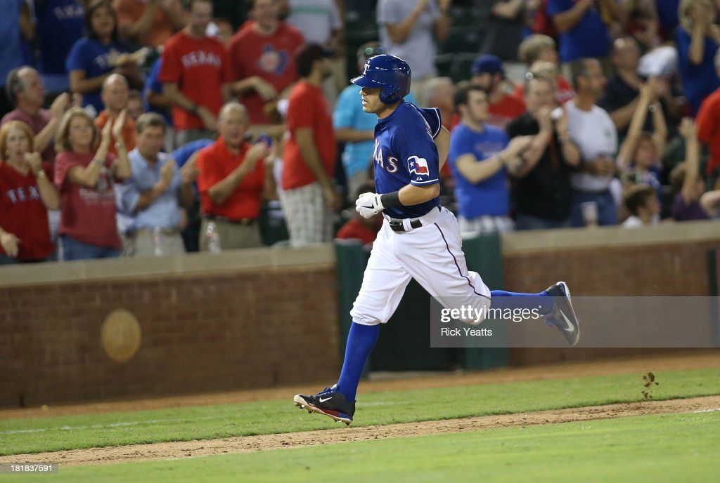 Ian Kinsler #5 of the Texas Rangers runs the bases after hitting a solo home run in the sixth inning against the Houston Astros at Rangers Ballpark in Arlington on September 25, 2013 in Arlington, Texas.