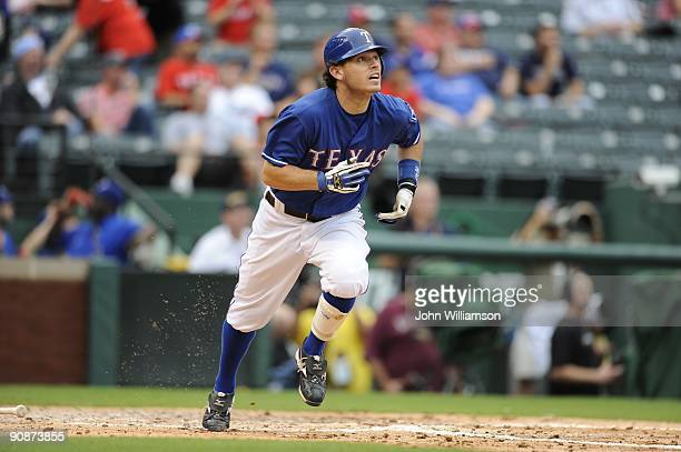 Ian Kinsler of the Texas Rangers runs to first base after hitting the ball during the game against the Seattle Mariners at Rangers Ballpark in...