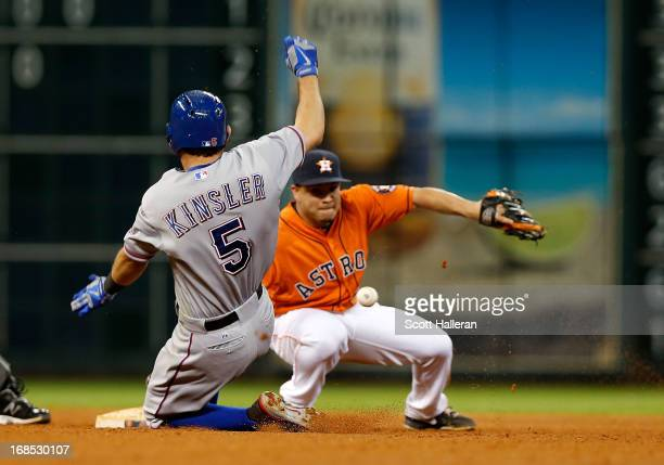 Ian Kinsler of the Texas Rangers slides into second base during the seventh inning as Jose Altuve of the Houston Astros fails to make a tag at Minute...