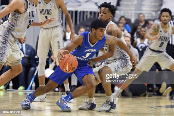 Ian Krishnan of the Central Connecticut State Blue Devils dribbles up the ball around James Akinjo of the Georgetown Hoyas during a college...