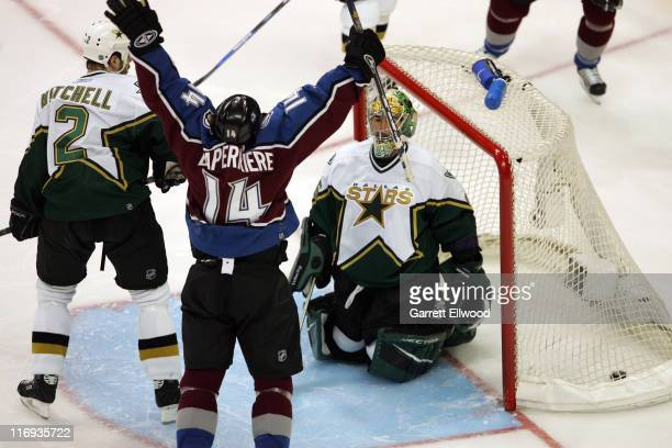 Ian Laperriere of the Colorado Avalanche celebrates the overtime goal of Alex Tanguay against the Dallas Stars during Game 3 of the Western...