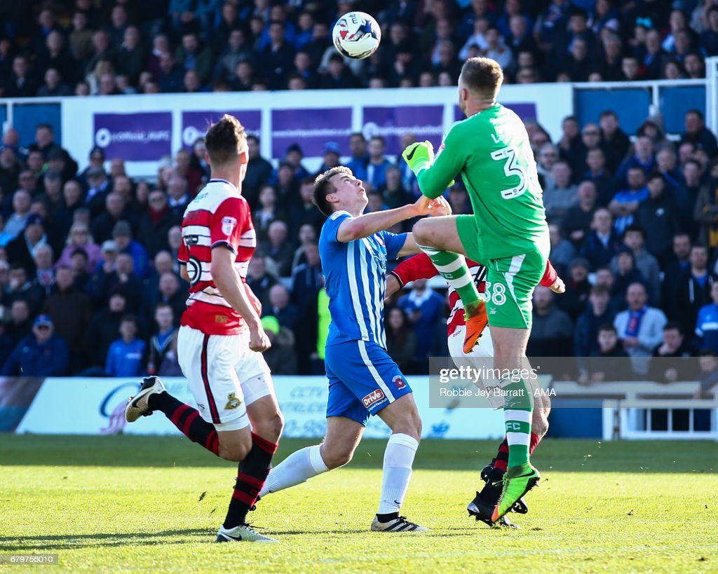 Ian Lawlor of Doncaster Rovers and Padraig Amond of Hartlepool United during the Sky Bet League Two match between Hartlepool United and Doncaster Rovers at Victoria Park on May 6, 2017 in Hartlepool, England.