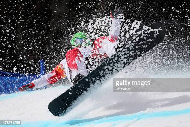 Ian Lockey of Canada competes during the Men's Para Snowboard Cross Standing on day seven of the Sochi 2014 Paralympic Winter Games at Rosa Khutor...