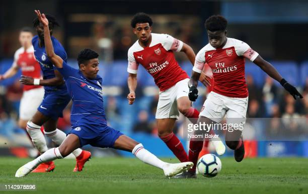 Ian Maatsen of Chelsea stretches for the ball that Bukayo Saka of Arsenal controls during the Premier League 2 match between Chelsea and Arsenal at...