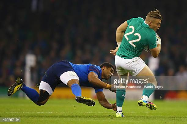 Ian Madigan of Ireland evades a tackle during the 2015 Rugby World Cup Pool D match between France and Ireland at Millennium Stadium on October 11...