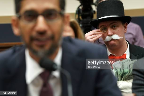 Ian Madrigal dresses as Mr Monopoly as Google CEO Sundar Pichai testifies before the House Judiciary Committee at the Rayburn House Office Building...