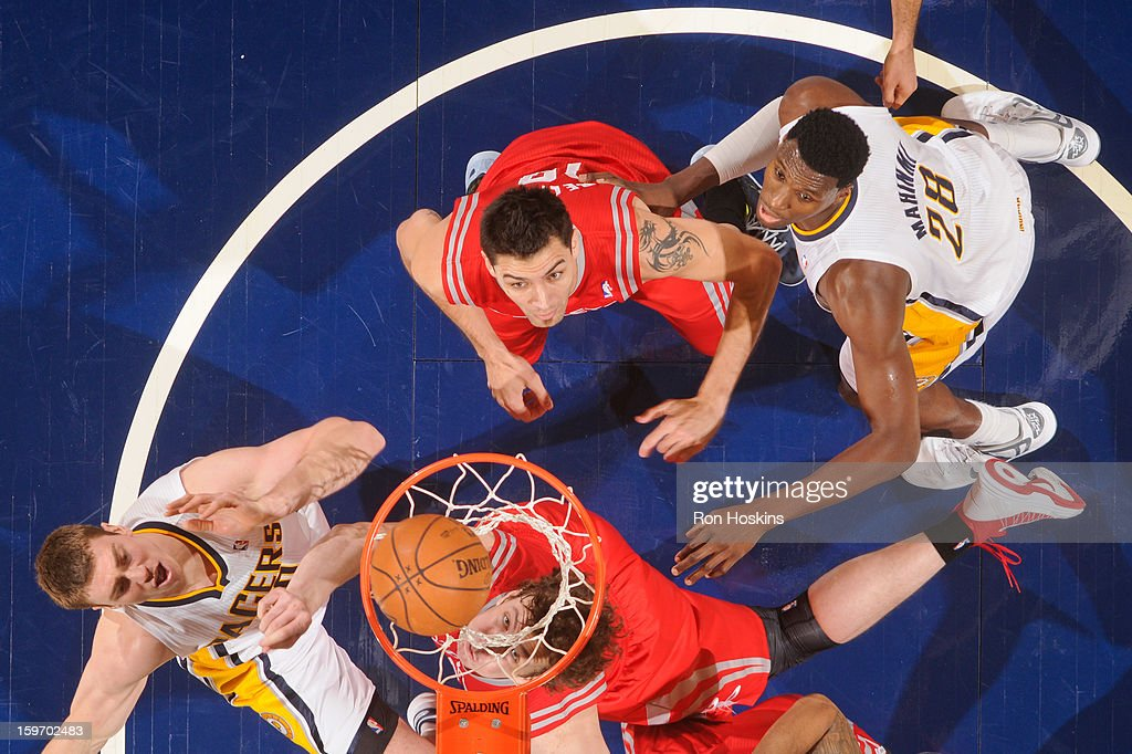 Ian Mahinmi #28 and Tyler Hansbrough #50 of the Indiana Pacers and Omer Asik #3 and Carlos Delfino #10 of the Houston Rockets watch as the ball goes in the cylinder during their game on January 18, 2013 at Bankers Life Fieldhouse in Indianapolis, Indiana.