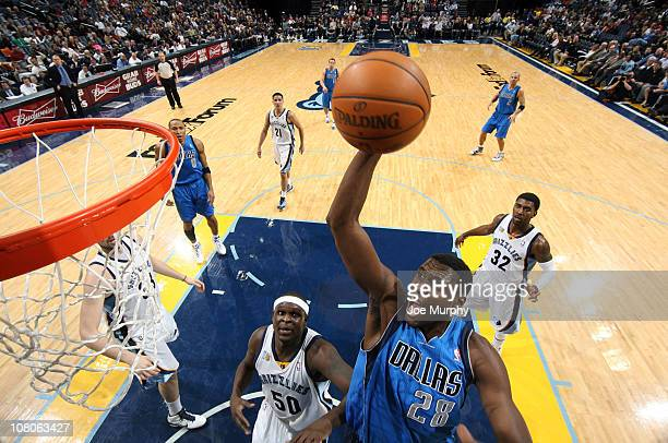 Ian Mahinmi of the Dallas Mavericks shoots against Zach Randolph of the Memphis Grizzlies on January 15 2011 at FedExForum in Memphis Tennessee NOTE...