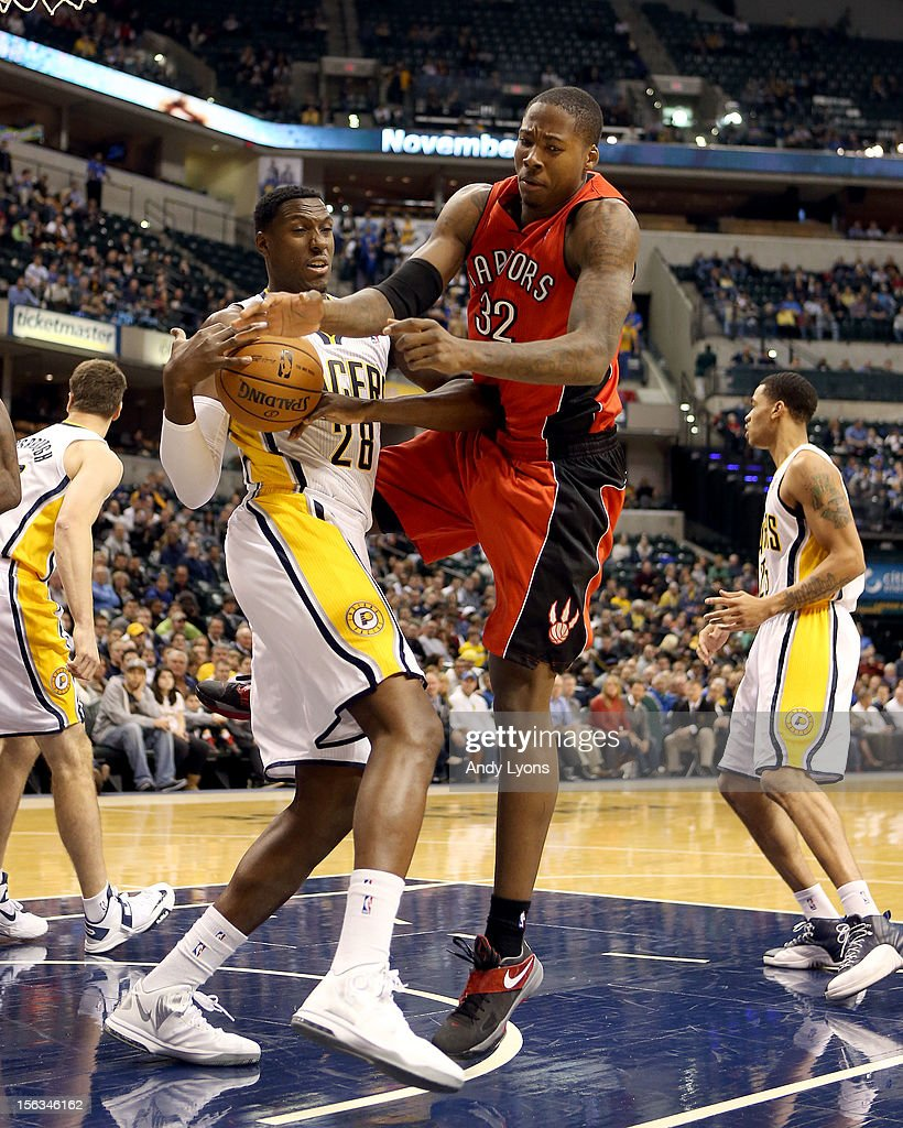 Ian Mahinmi #28 of the Indiana Pacers and Ed Davis #32 of the Toronto Raptors battle for a rebound during the NBA game at Bankers Life Fieldhouse on November 13, 2012 in Indianapolis, Indiana.