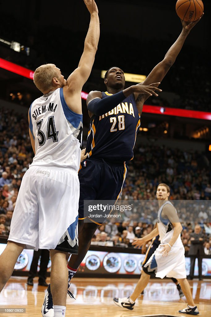 Ian Mahinmi #28 of the Indiana Pacers drives to the basket against Greg Stiemsma #34 of the Minnesota Timberwolves on November 9, 2012 at Target Center in Minneapolis, Minnesota.