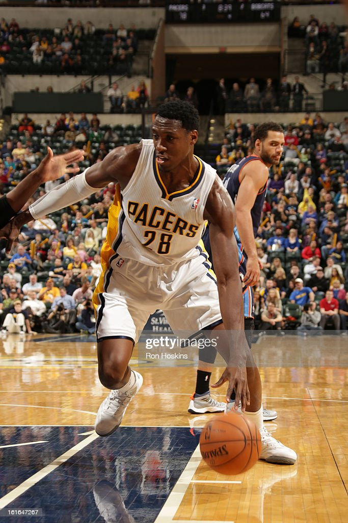 Ian Mahinmi #28 of the Indiana Pacers drives to the basket against the Charlotte Bobcats on February 13, 2013 at Bankers Life Fieldhouse in Indianapolis, Indiana.