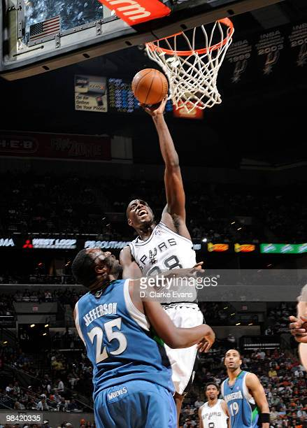Ian Mahinmi of the San Antonio Spurs shoots against Al Jefferson of the Minnesota Timberwolves on April 12 2010 at the ATT Center in San Antonio...