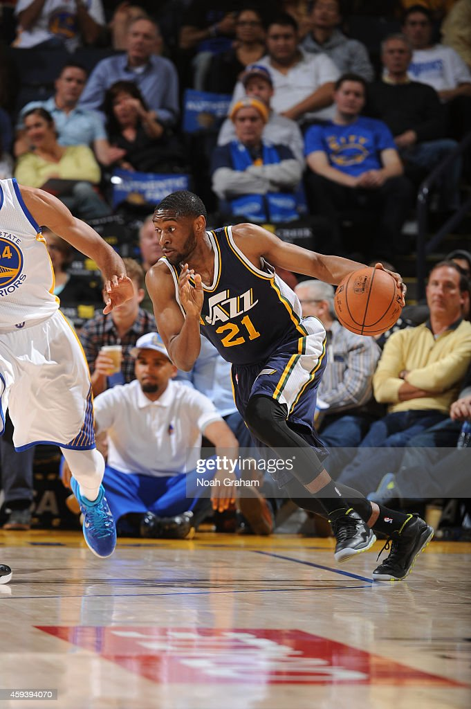 Ian Mahinmi #28 of the Utah Jazz drives against the Golden State Warriors on November 21, 2014 at Oracle Arena in Oakland, California.