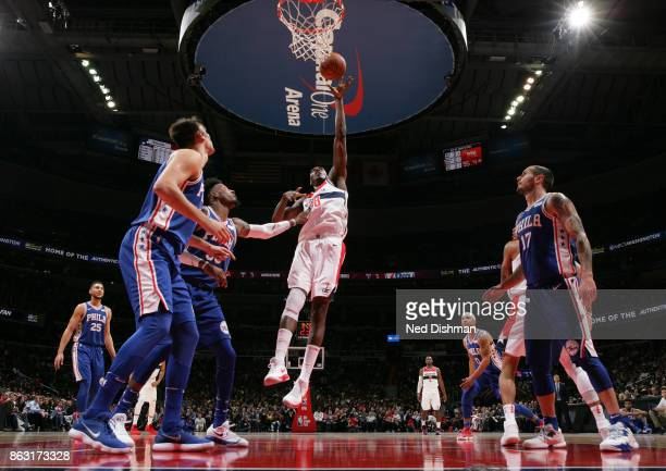 Ian Mahinmi of the Washington Wizards drives to the basket against the Philadelphia 76ers on October 18 2017 at Capital One Arena in Washington DC...