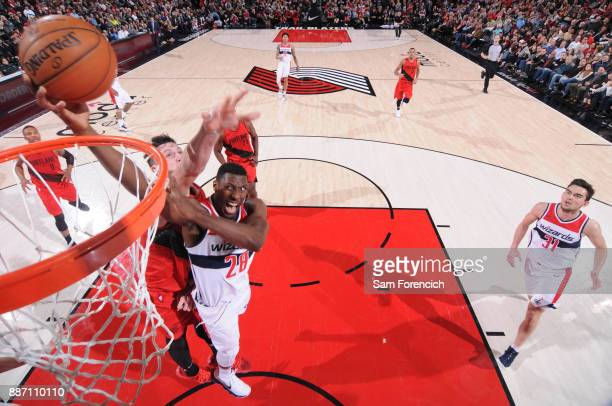 Ian Mahinmi of the Washington Wizards drives to the basket around Jusuf Nurkic of the Portland Trail Blazers on December 5 2017 at the Moda Center...