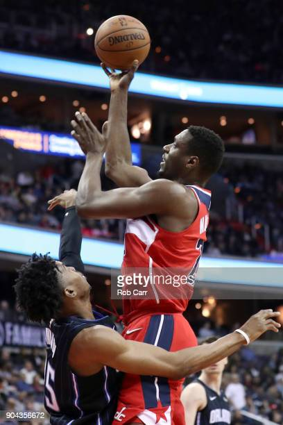 Ian Mahinmi of the Washington Wizards puts up shot over Wesley Iwundu of the Orlando Magic in the second half at Capital One Arena on January 12 2018...