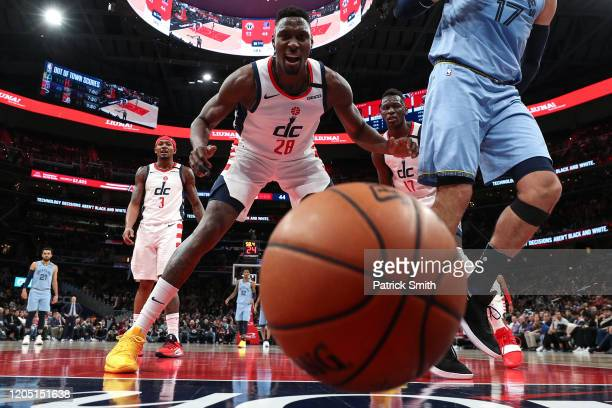 Ian Mahinmi of the Washington Wizards reacts as the ball bounces off of Jonas Valanciunas of the Memphis Grizzlies at Capital One Arena on February...